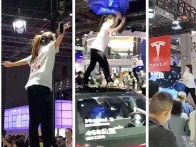上海国际车展女子站车顶大闹展位 特斯拉回应